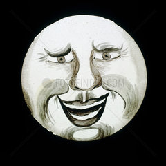 'Laughing face'  hand-coloured magic lantern slide  19th century.
