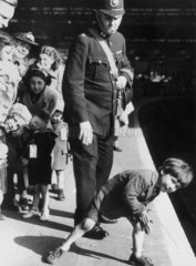 Policeman with evacuees at a London railway station  28 September 1940.