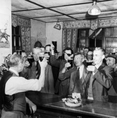 Men drinking beer in a pub  May 1945.