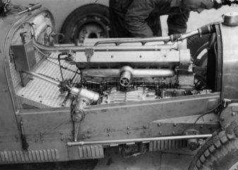 Mechanic working on a Bugatti racing car  Nurburgring  Germany  1932.