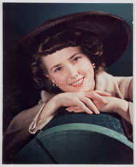 Woman modelling a hat  c 1940s.