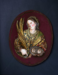 Wooden plaque of St Lucy of Syracuse  Spanish  17th century.