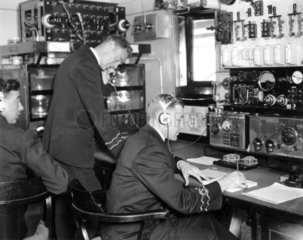 Officials in the wireless room on the 'Viceroy of India'  19 Febuary 1934.