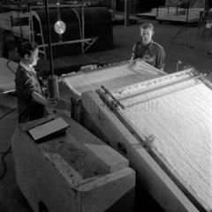 Workers card asbestos material on production machine  Turner Asbestos.