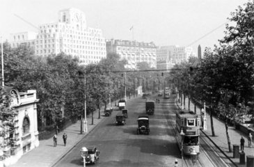 Trams and motor vehicles driving along the