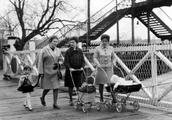 Women walking over a level crossing  Earby  Lancashire  April 1968.