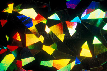 Coated paper. Light micrograph in oblique.