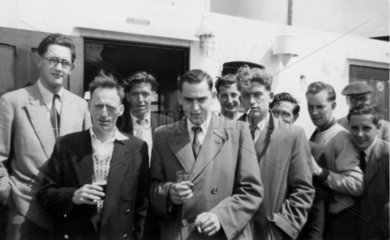 A group of men on board a ferry  England  1950s.