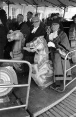 Riding the merry-go-round at Maidstone May Queen Fair  1968.