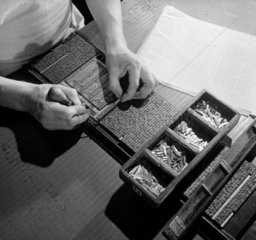 Close up of typesetter's hands correcting metal galley  1963.
