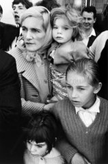 Mother and child in a crowd  London  c 1960.