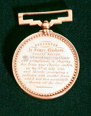 Gallantry medal presented to locomotive engine driver James Clarkson  1861.