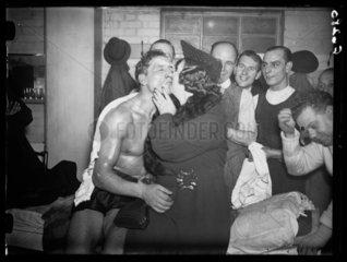 Eddie Phillips receives a kiss  1937.