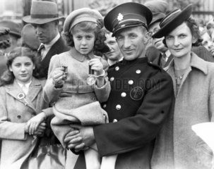 Fireman and his family with medal  Buckingham Palace  8 May 1945.
