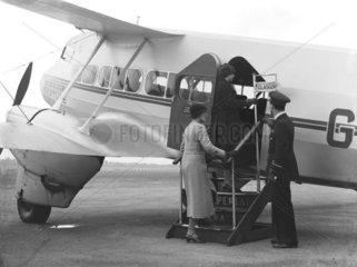 Passengers boarding an aeroplane  Croydon  London  1936.