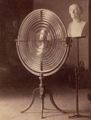 Fresnel lens used by Melloni and a bust of Melloni  1876.