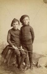 Two boys dressed as fishermen  c 1901-1910.