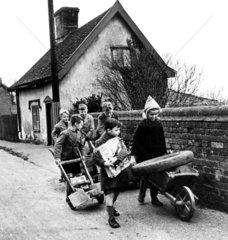 Children pushing wheelbarrows  9 December 1