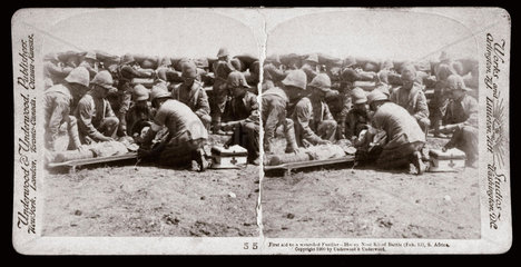 First aid to a wounded Fusilier - Honey Nest Kloof Battle  South Africa'  1900.