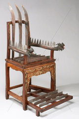 Wooden torture chair with 12 steel blades  Chinese  1701-1900.
