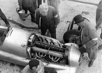 Looking at a Mercedes racing car engine  Nurburgring  Germany  1934.