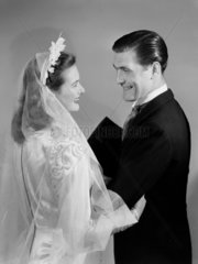 Smiling bride and groom  c 1949.