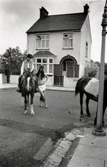 Woman (astride a horse) with man  both wearing fancy dress  1968.
