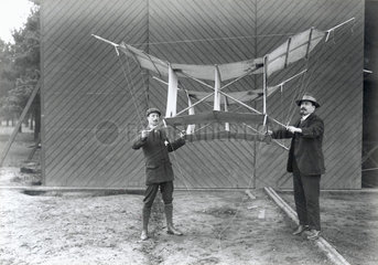 S F Cody (right) and another man holding a manlifting kite  c 1905.
