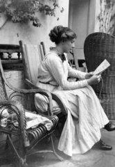 Woman wearing a long dress sitting in a