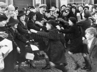 Evacuee children greeting their parents from London  4 December 1939.
