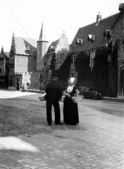 Dutch couple in conversation  c 1910s.