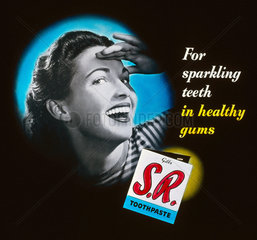 'For sparkling teeth in healthy gums' toothpaste advertisement  1950s.