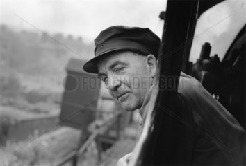 Driver Bill Hoole leans from the cab of his A4 class locomotive  c 1950s.