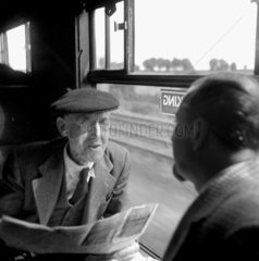 Old man talking to Colin Wills of the BBC during a train journey  1950.