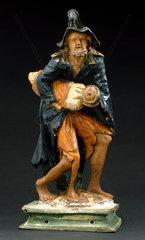 Wooden figure of Saint Roman bearing off a child  European  1801-1900.