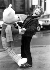 Boy with giant Rupert Bear  January 1984.