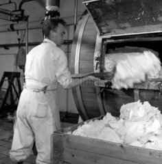 Man piling butter on to a conveyor at a Campbeltown dairy  Scotland  1950.
