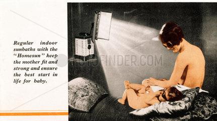 Mother and child experiencing indoor sunbat