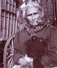 Old Romany woman smoking a pipe  c 1900s.