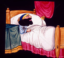 Man with a large beard in bed  mid 19th century.