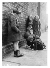 Children drawing on the pavement  1941.