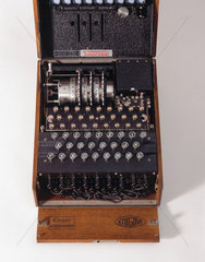 Three-ring Enigma cypher machine in wooden transit case  c 1930s.