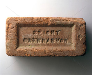 Brick from old sea wall at Rhoscolyn Bay  Anglesey  Wales.