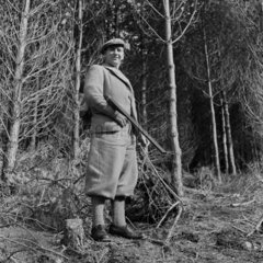 Gamekeeper carrying his gun in a forest near Loch Tay  Scotland  1951.