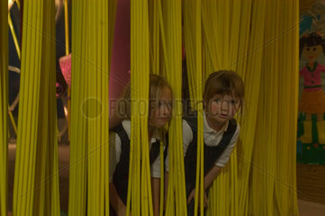 Children playing in plastic curtain  Science Museum  London  2007.