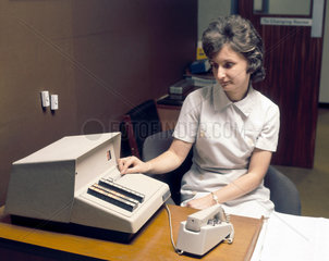 Computer terminal at a BUPA medical centre  1975.