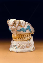 Upper and lower denture contained in porcelain holder  c 1780-1820.