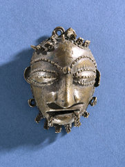 Pendant in the form of a human mask  Nigerian  1801-1920.