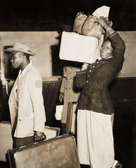 Woman arriving from Barbados  4 January 1955.