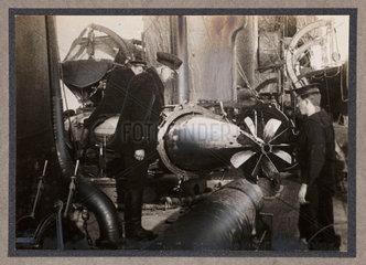 Inspecting a torpedo  c 1916.